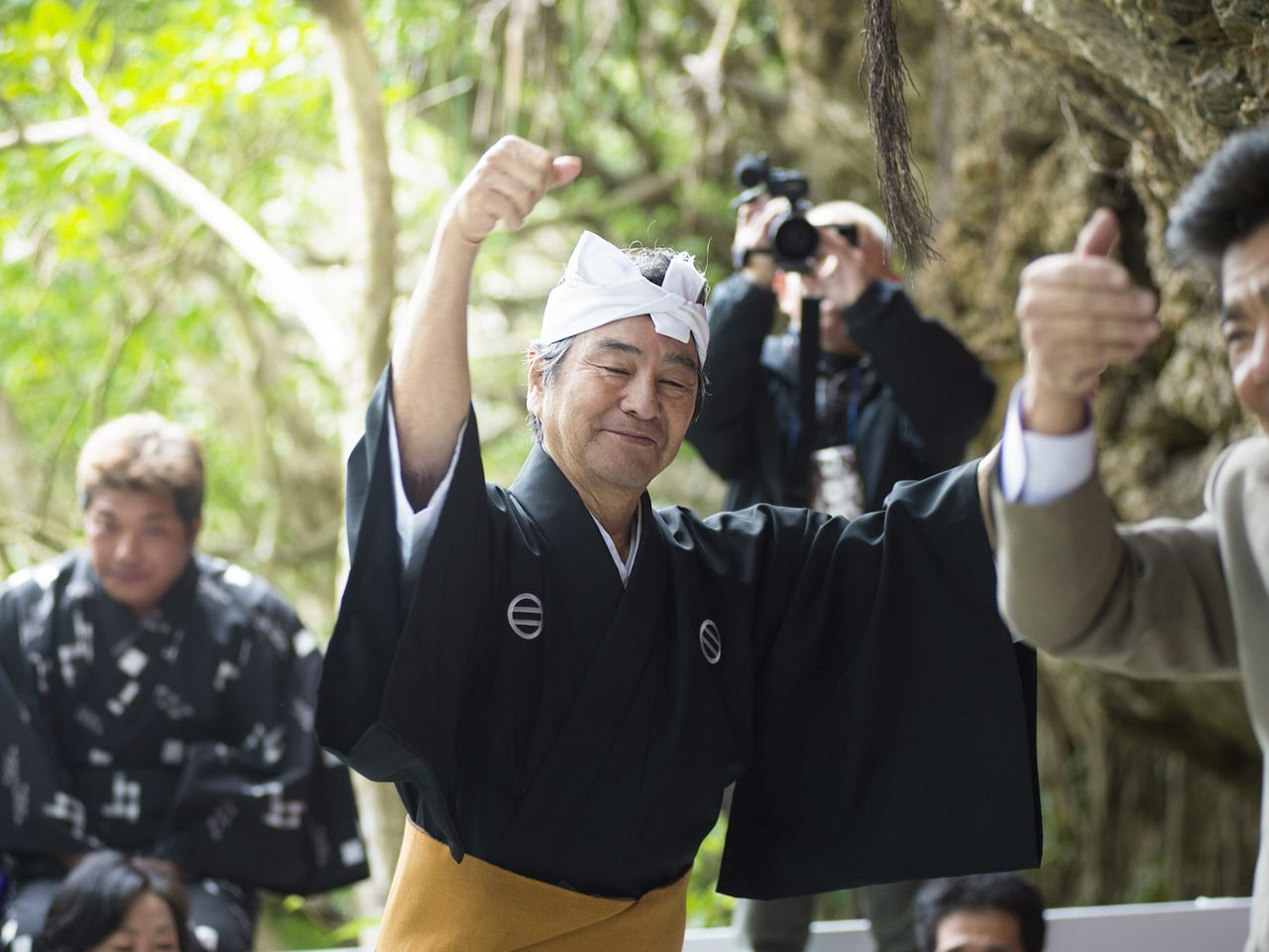 Dancing the <em>kachāshī</em> to <em>sanshin</em> music after offerings have been performed.