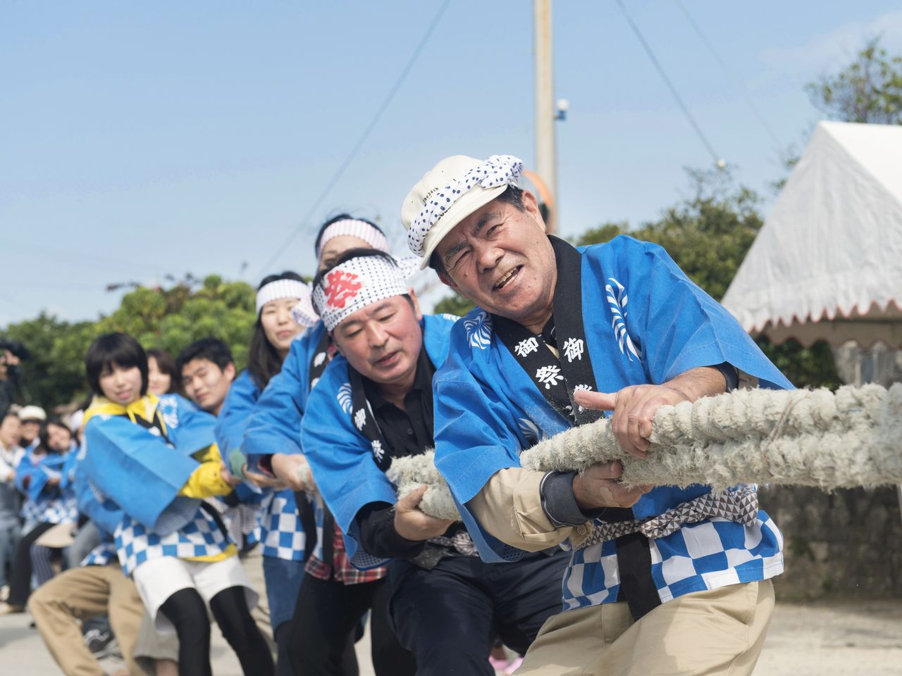 Participants put their backs into the north-south tug of war.