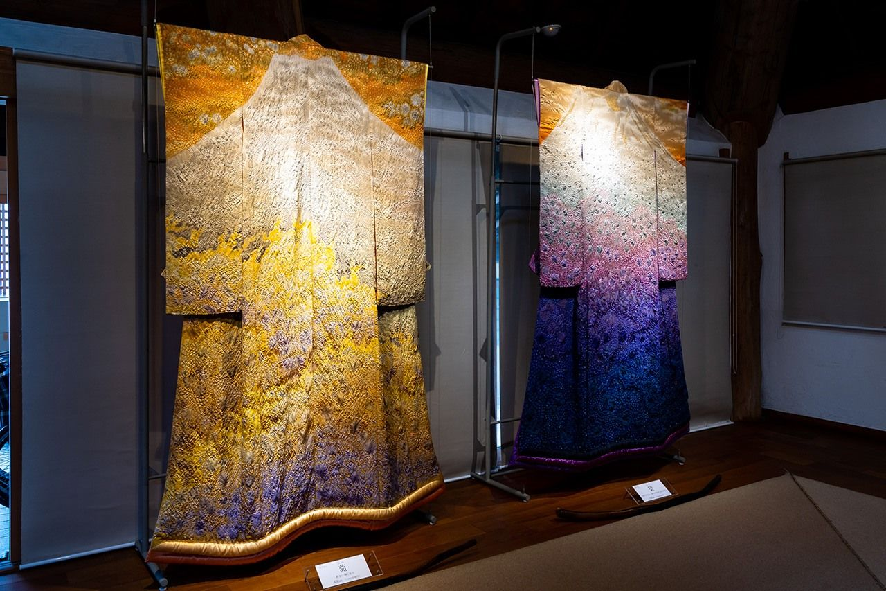 Robes on display at the museum. At left is the 1991 Ohn (菀), depicting a golden Mount Fuji; Miyahara Sakuo, apprentice to Itchiku, assisted in its creation.