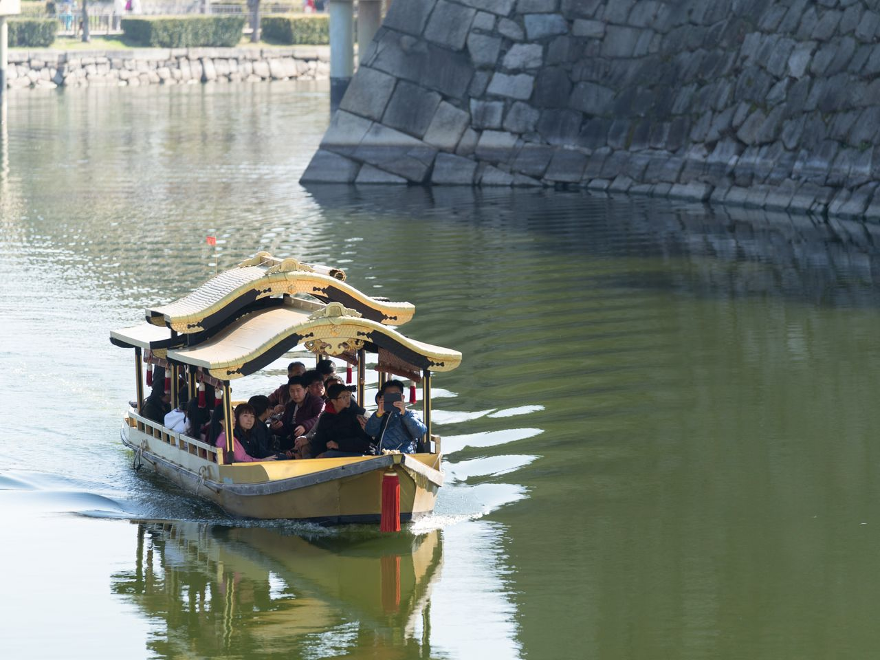 Osaka Castle <em>gozabune</em> pleasure boat plying the waters of the castle's inner moat on its 20-minute course.