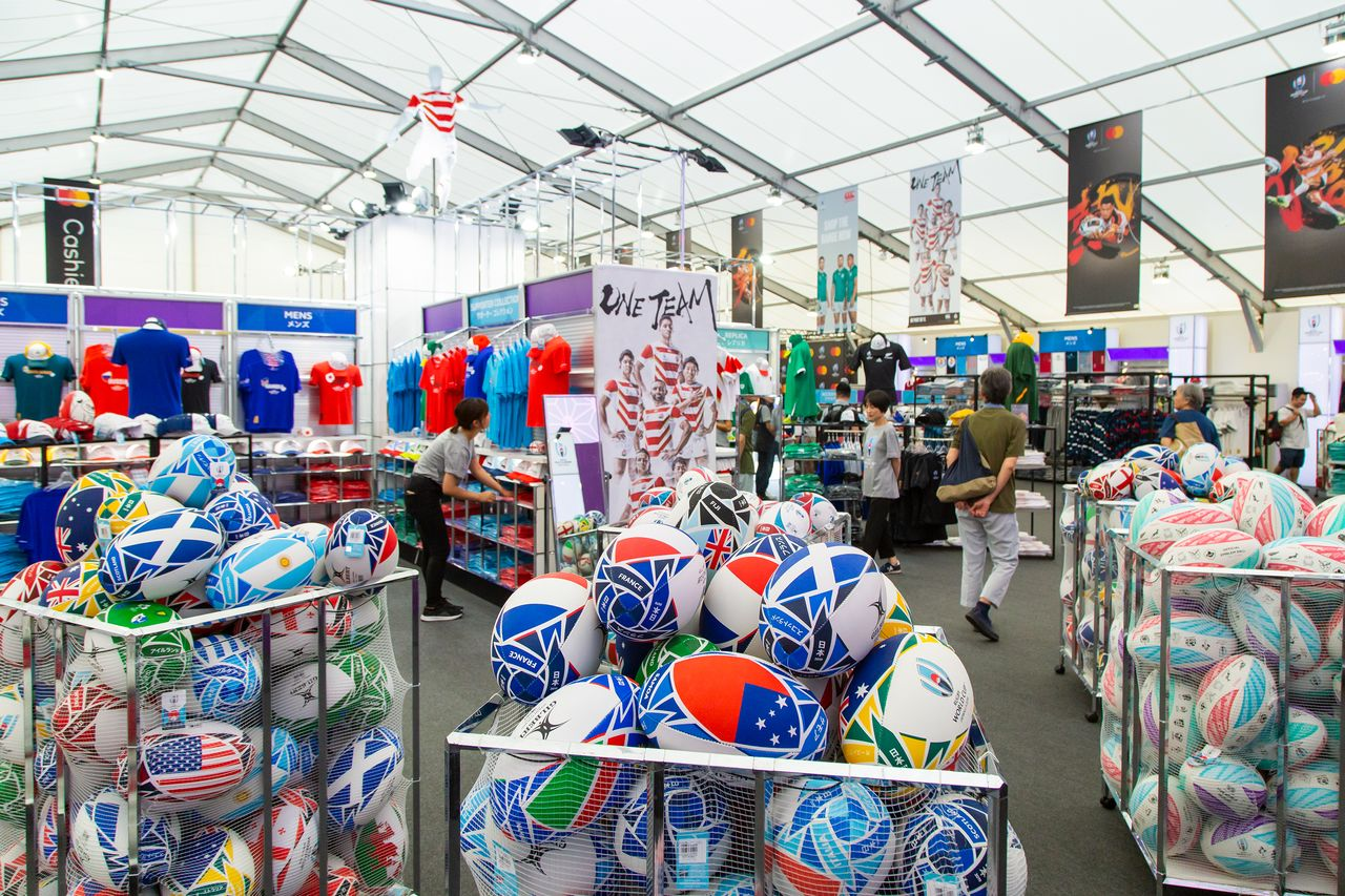 The Megastore has an array of merchandise, including balls featuring the flags of the competing nations.