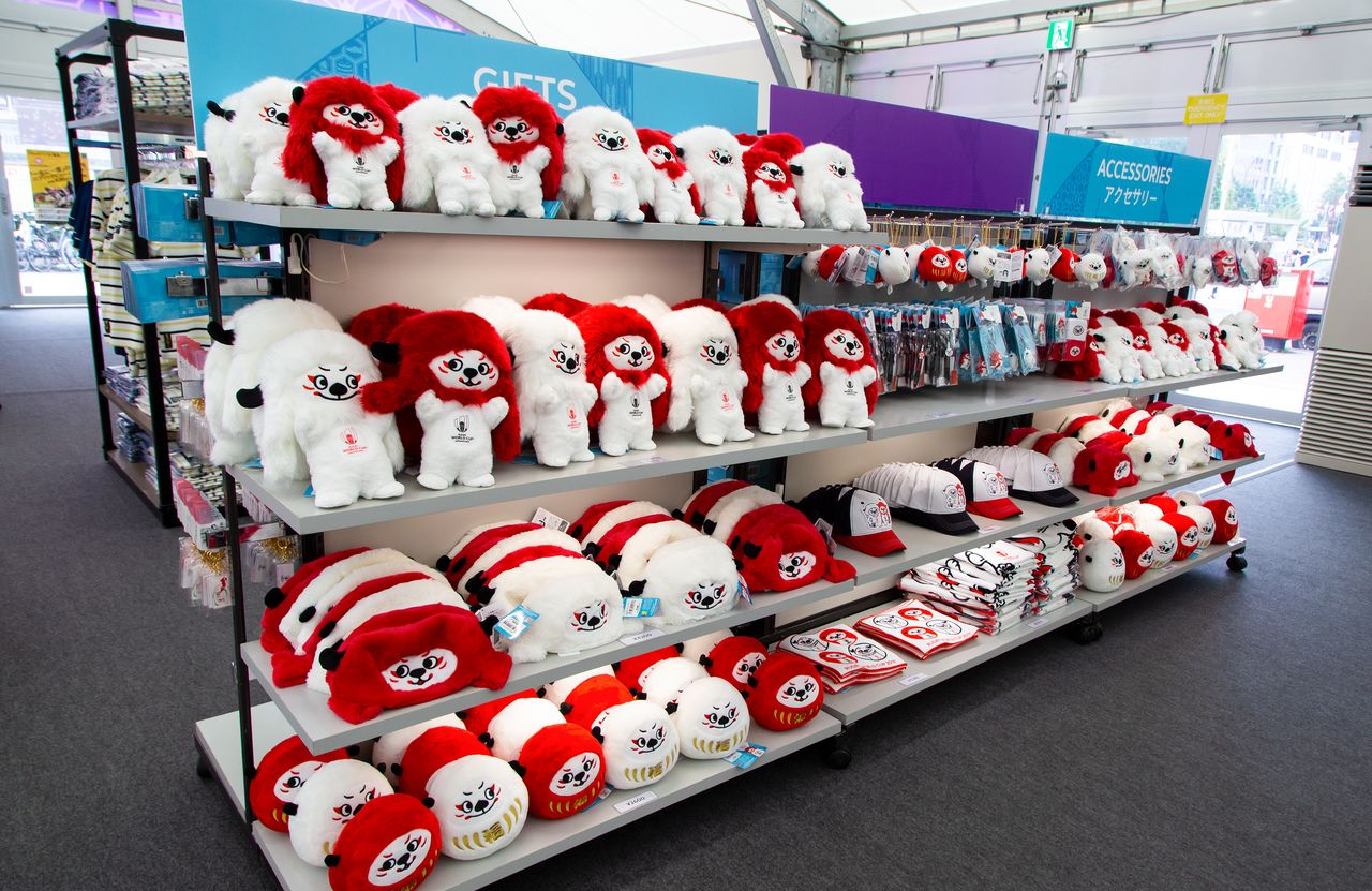 Red and white dolls of Ren-G, the Rugby World Cup 2019 mascot. The character is modeled on Japanese renjishi, a mythical lion-like creature.