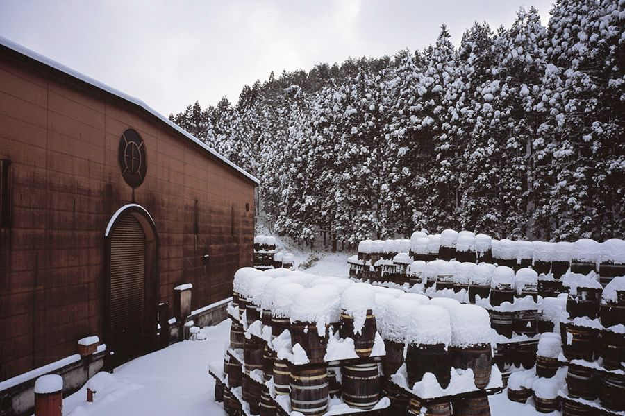 Fog and haze are common in the damp Miyagikyō gully, where winter can bring heavy snowfall. The moisture in the air keeps the barrels from drying and helps to lock in the whisky's aroma. (Courtesy Sendai Nikka Service)