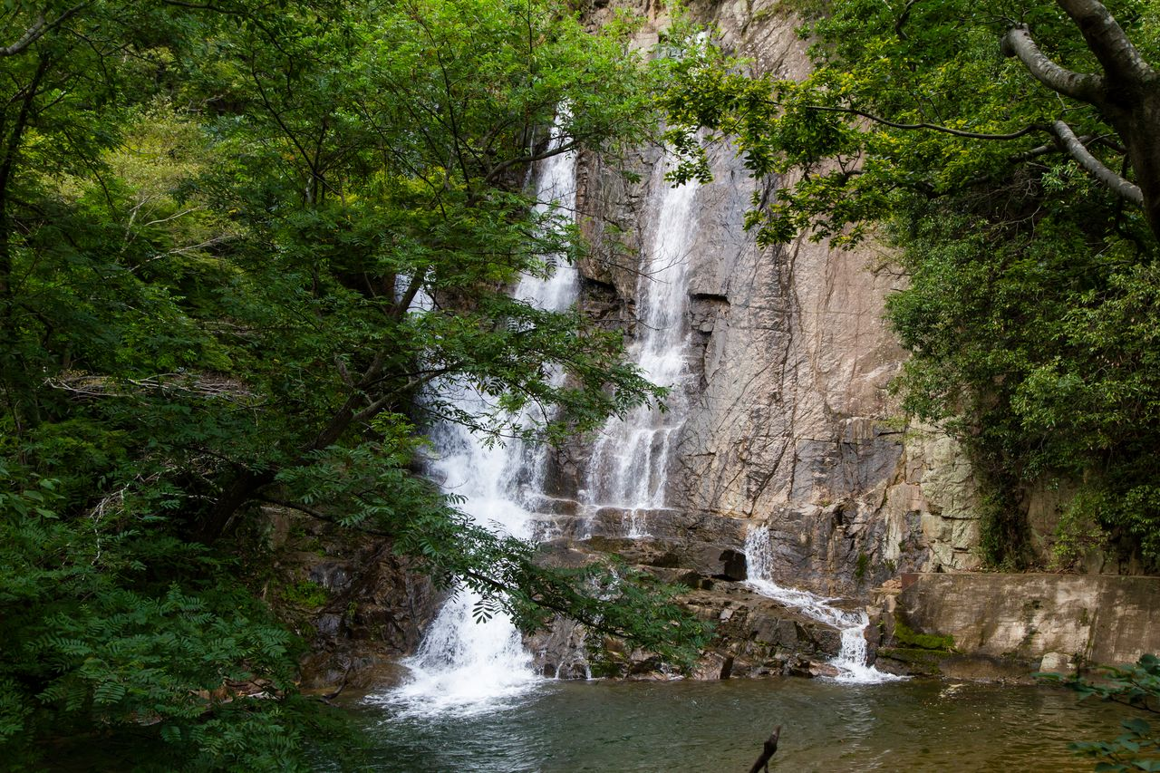 "The Gohonmatsu Kakuredaki, or ""hidden falls,"" appear only when the reservoir level is high enough to open up the dam's spillway."