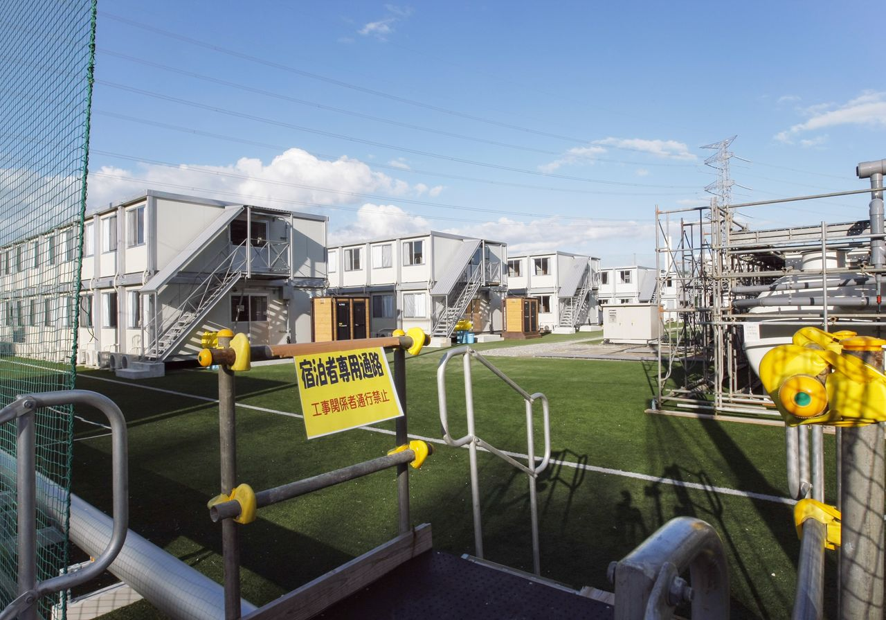 Temporary housing for TEPCO employees built atop a pitch. Photo taken in September 2011. (© Jiji)