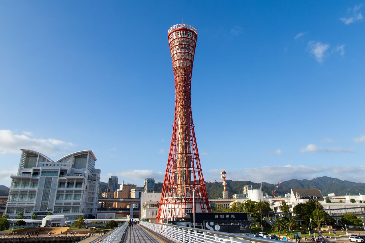 Kobe Port Tower, a local landmark. The structure, shaped like a traditional hand drum, has a five-story observation deck at the top.
