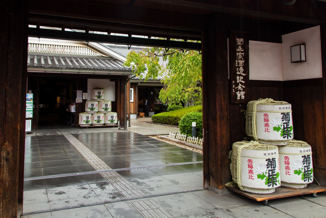Barrels wrapped in decorative coverings at the entrance to the Kiku Masamune Sake Brewery Museum.