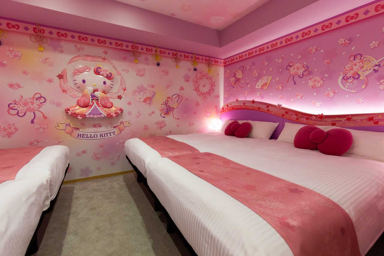 Hello Kitty covers the walls of the Sakura Tennyo room. The bed cushions are shaped like the character's trademark bow.