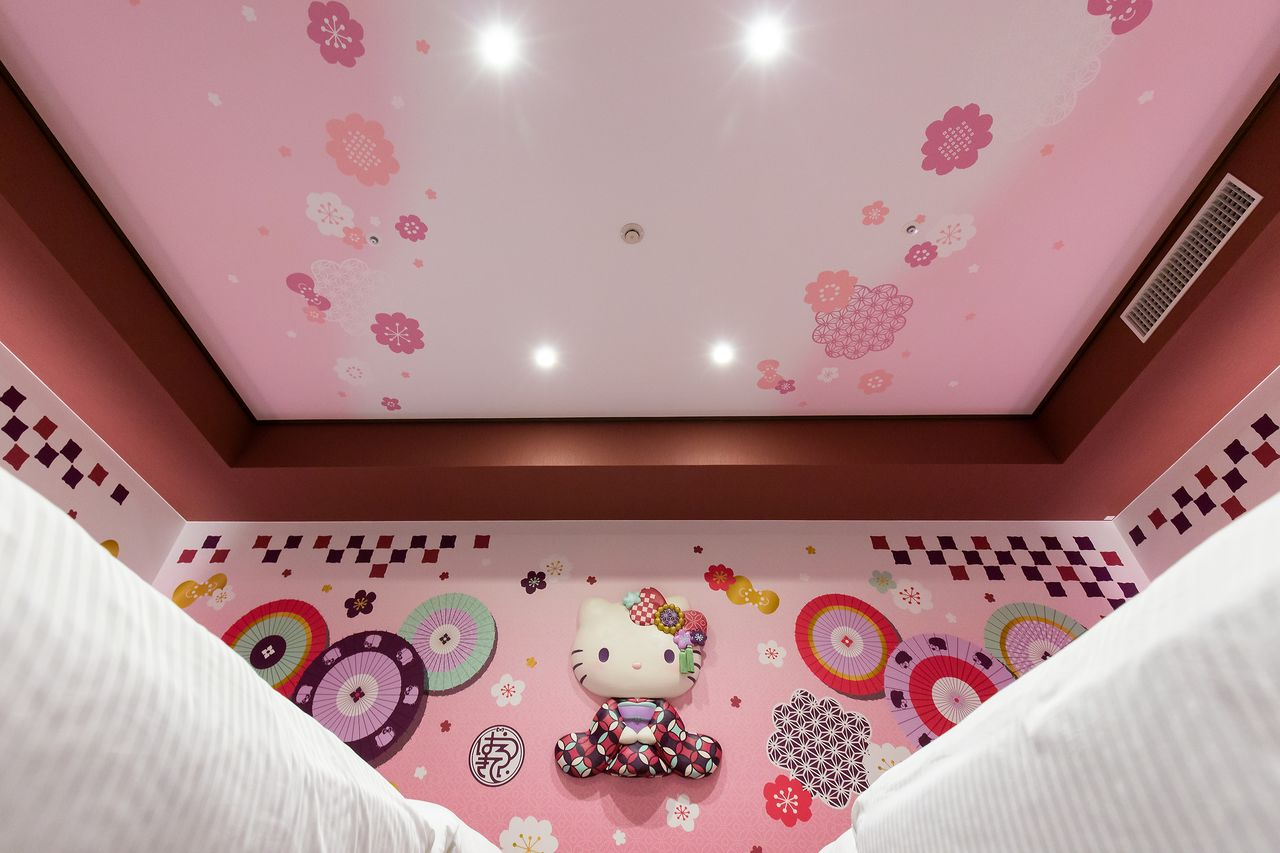 Even the ceiling is pink and embellished with chic traditional motifs to match the rest of the room.