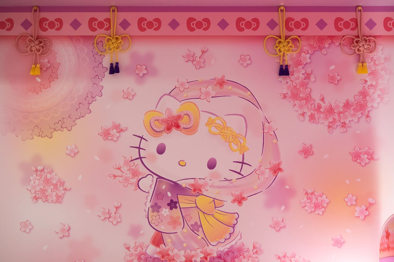 Traditional kumihimo braided cords hanging from the ceiling are shaped into Hello Kitty bows.