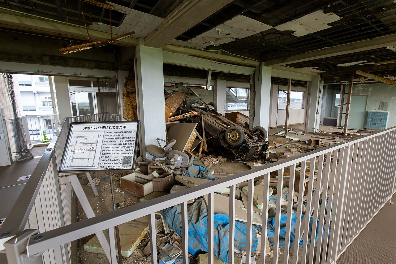 A car washed away by the tsunami settled on the third floor of the school. Information throughout the museum is available in Japanese, English, Chinese, Korean, and Indonesian.