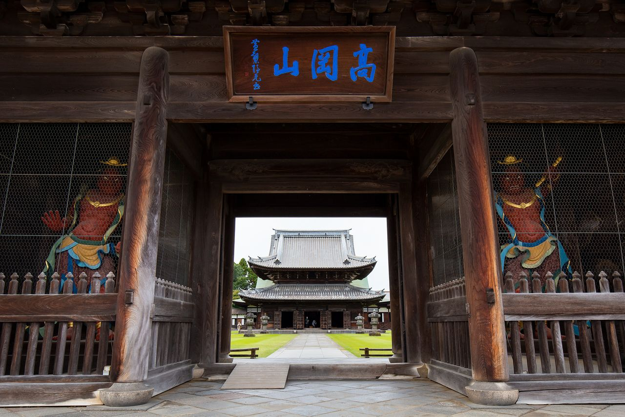 """The Butsuden, or Buddha hall, is framed perfectly by the Sanmon. The wood tablet above the entrance reads """"Takaokasan,"""" another name for the temple, and was written by the famous priest Ingen Ryūki, founder of the Ōbaku school of Zen."""