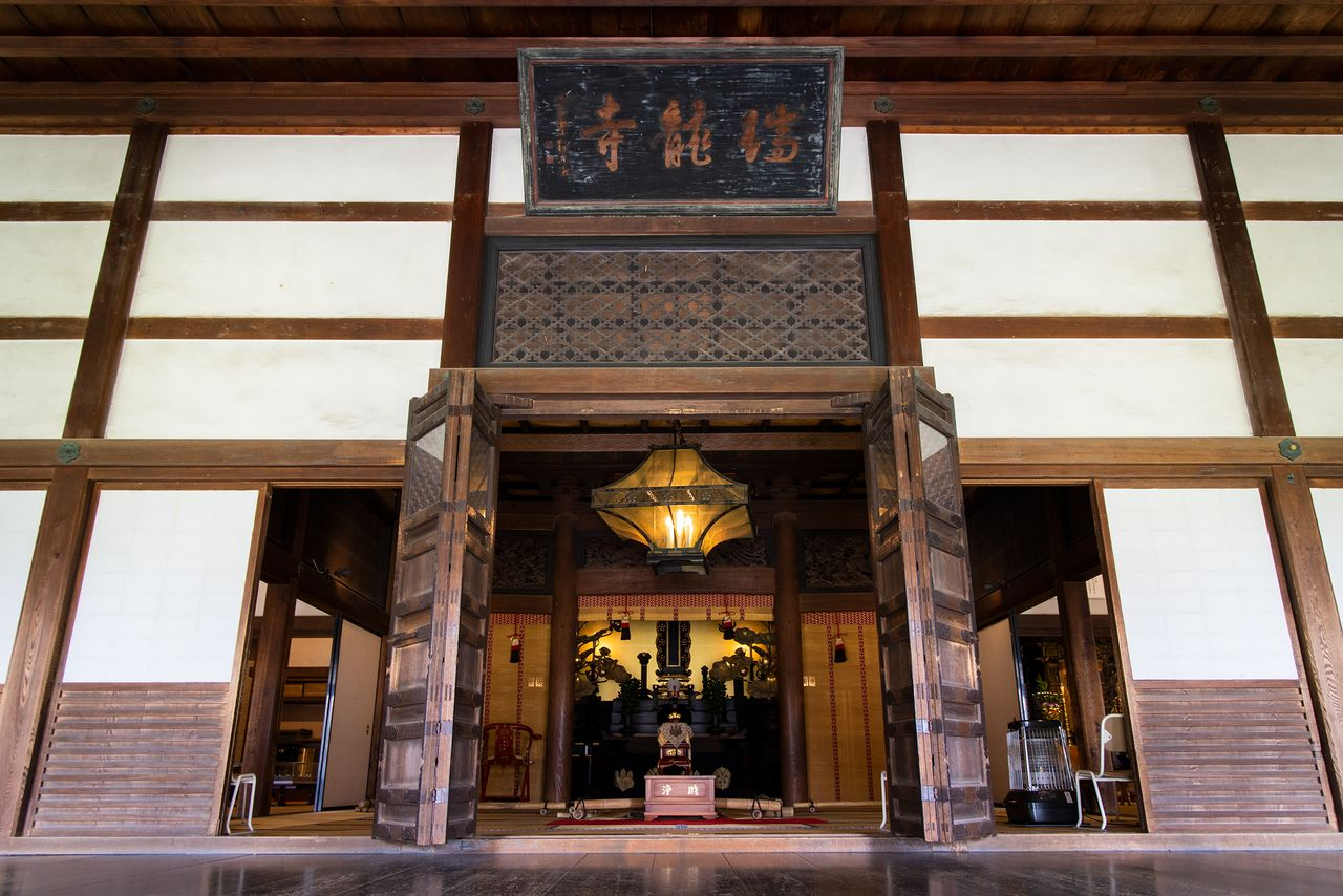 Toshinaga's mortuary tablet is placed on the Buddhist altar in the center of the Dharma hall.