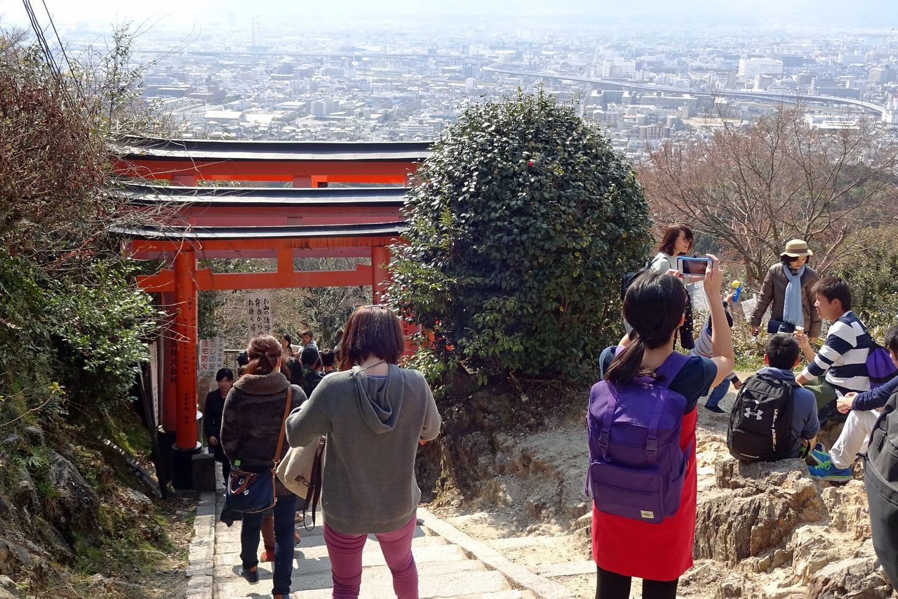 The path to the Fushimi Inari Shrine offers an unobstructed view of Kyoto and surrounding hills.