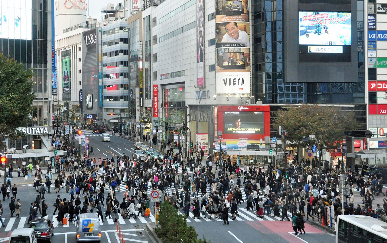 Pedestrians swarm over Shibuya's scramble crossing.