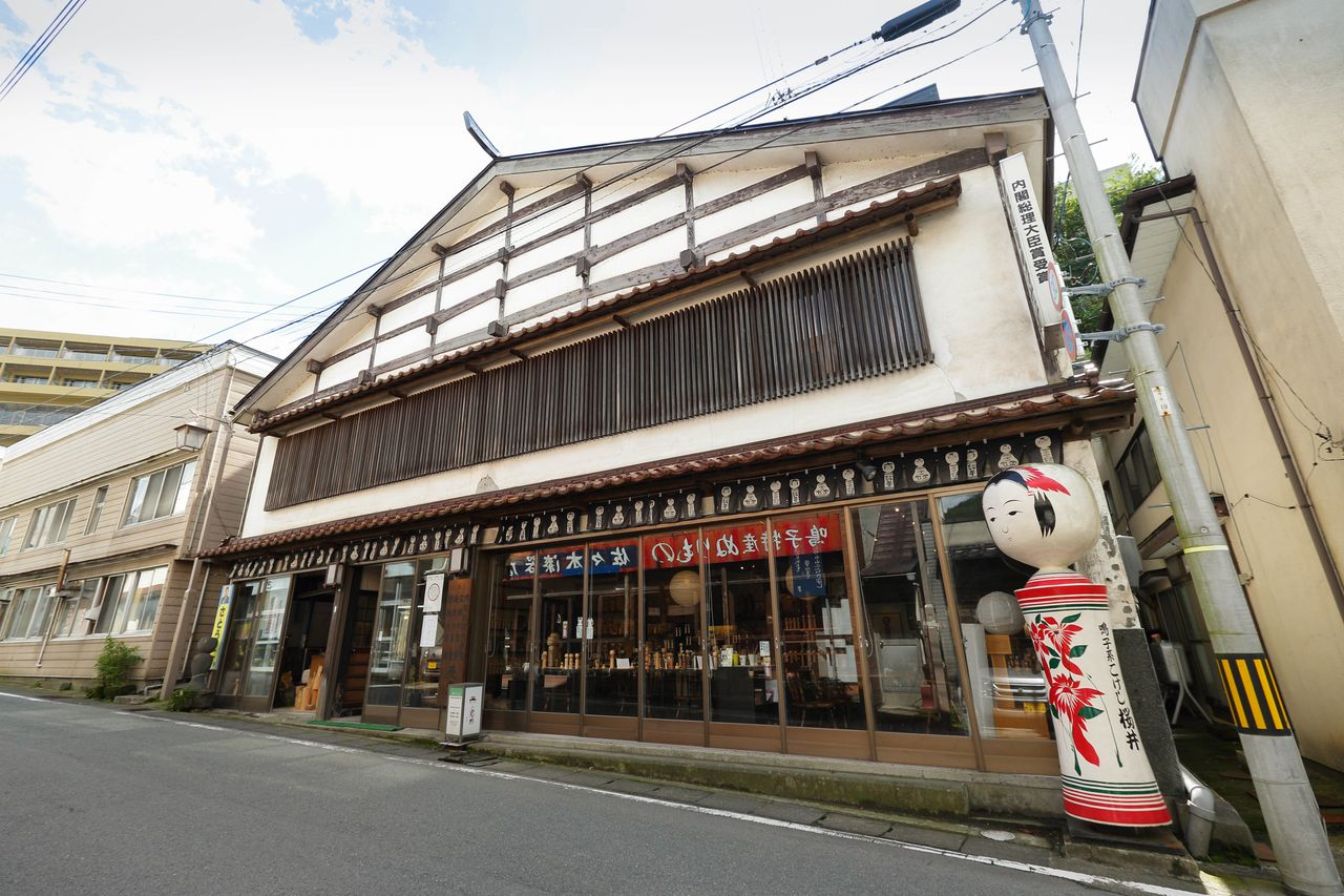 The giant <em>kokeshi</em>  doll out front makes it easy to find Sakurai Kokeshi. (© Shoe Press)