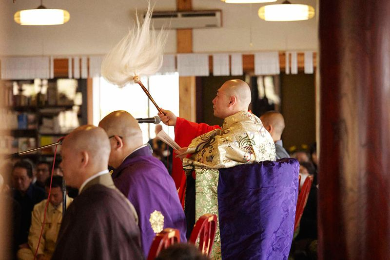 The priest weeps as he chants the sutras, overcome by grief as he recites the posthumous Buddhist names of more than 160 people in one ceremony.