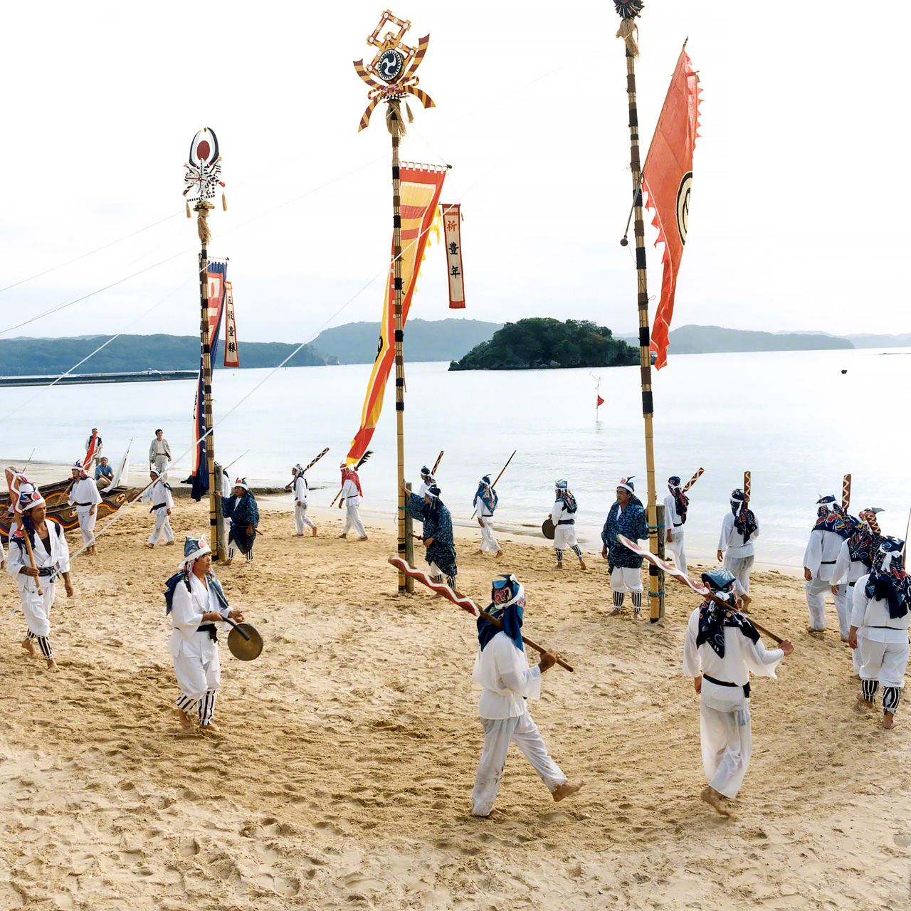 In this ceremony during an Iriomotejima festival, participants sing as they carry paddles.