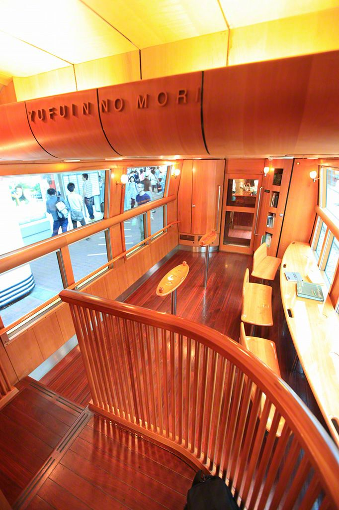 The lounge car in the Yufuin no Mori train, where passengers can get a bite to eat and enjoy the scenery.