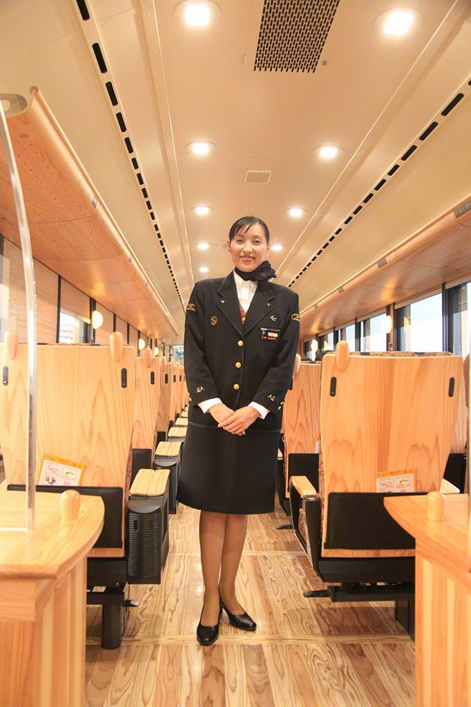 "A customer service representative is available at all times on tourist trains throughout Kyūshū, helping passengers find their seats, taking souvenir snaps, and arranging ""kamishibai"" story-telling sessions and other entertainment."