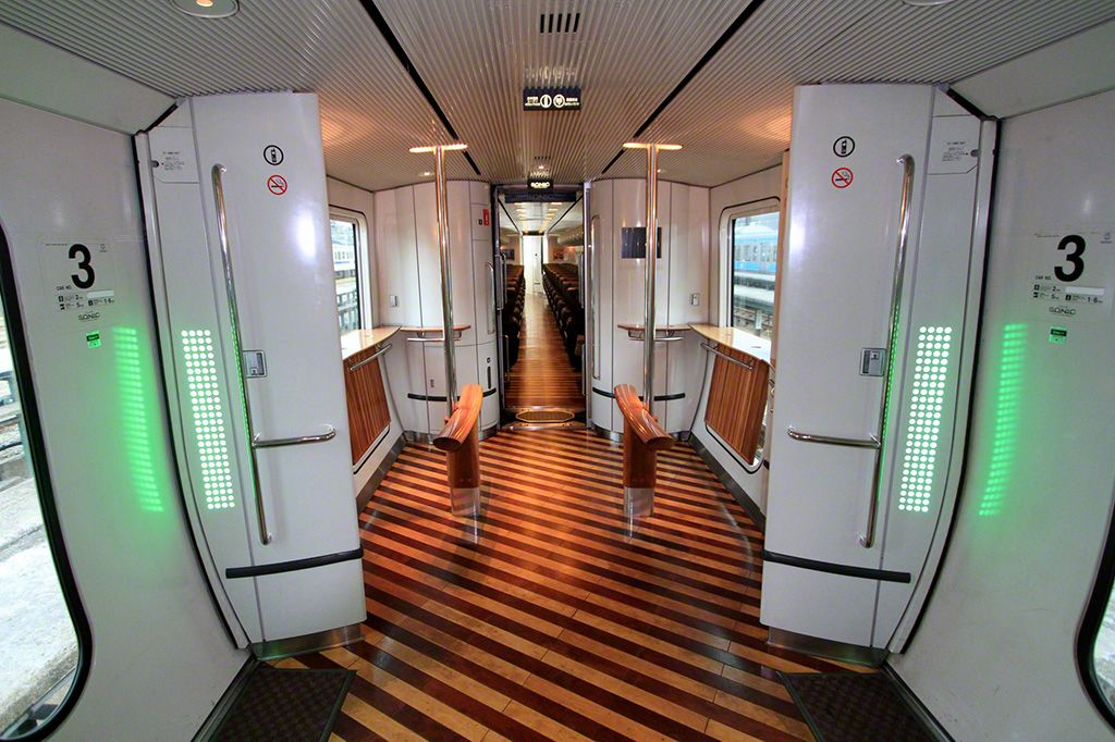 The deck on the Shiroi Kamome train. Passengers can use this common area to relax and enjoy their journey.