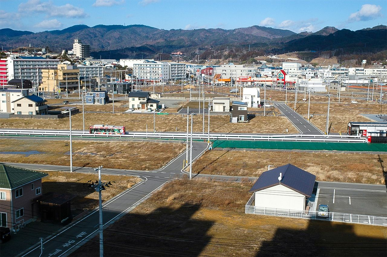 Vacant lots give the newly redeveloped district of Minami Kesennuma a deserted look.