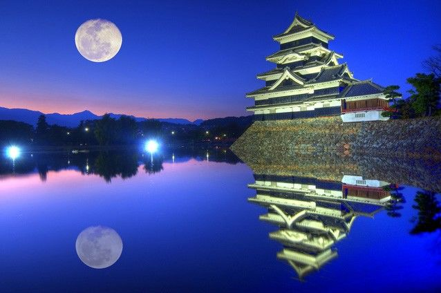 The full moon over Matsumoto Castle in Nagano Prefecture.