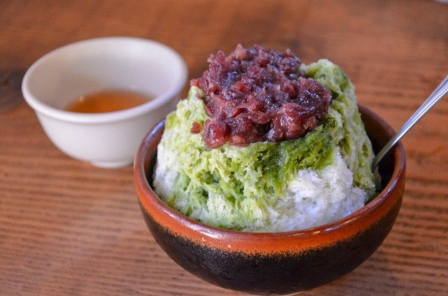 Ujikintoki shaved ice is made with coarse bean paste, matcha, and sugary syrup.