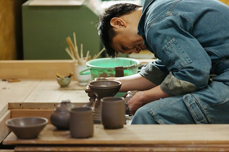 Masanori is totally absorbed as he works on the wheel.