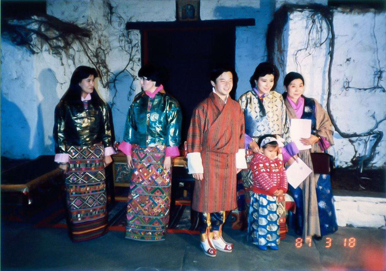 Crown Prince Naruhito in traditional Bhutanese dress at a palace banquet. Queen Mother Kesang Choden is at right of the picture, taken in March 1987. (Courtesy Saitō Katsuhisa)