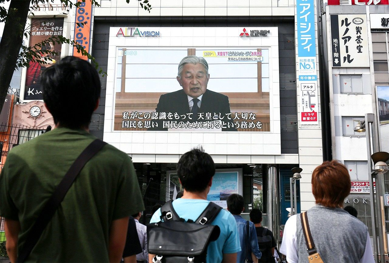 Emperor Akihito's video message is relayed on a giant screen in Shinjuku, Tokyo, on August 8, 2016.