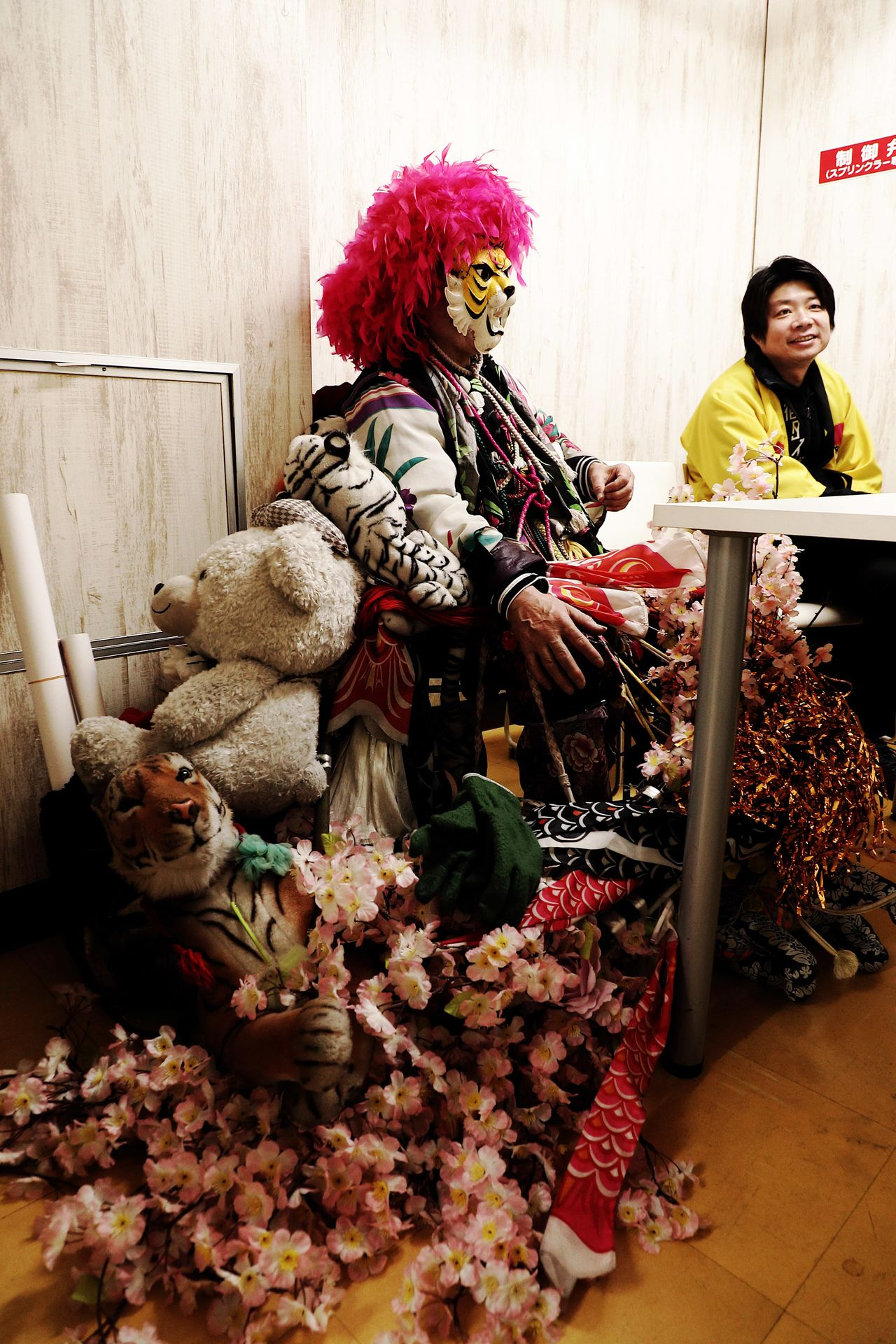 "Shinjuku Tiger in his handmade costume, accompanied by his ""family"" of stuffed animals"