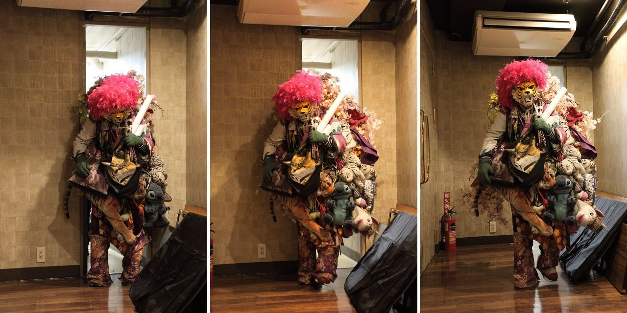 Tiger squeezes through a narrow door backstage at Theatre Shinjuku. His bulky costume weighs more than 10 kilograms.