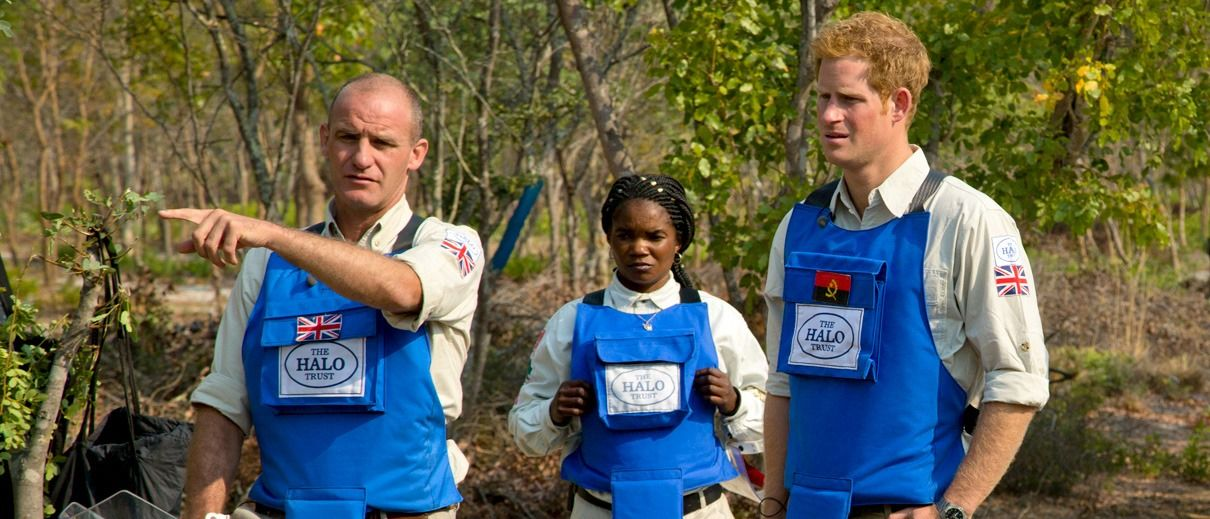 Britain's Prince Harry (right) visits a minefield in Angola in 2013. Like his mother Princess Diana, he is a vocal advocate of demining. (© HALO Trust)