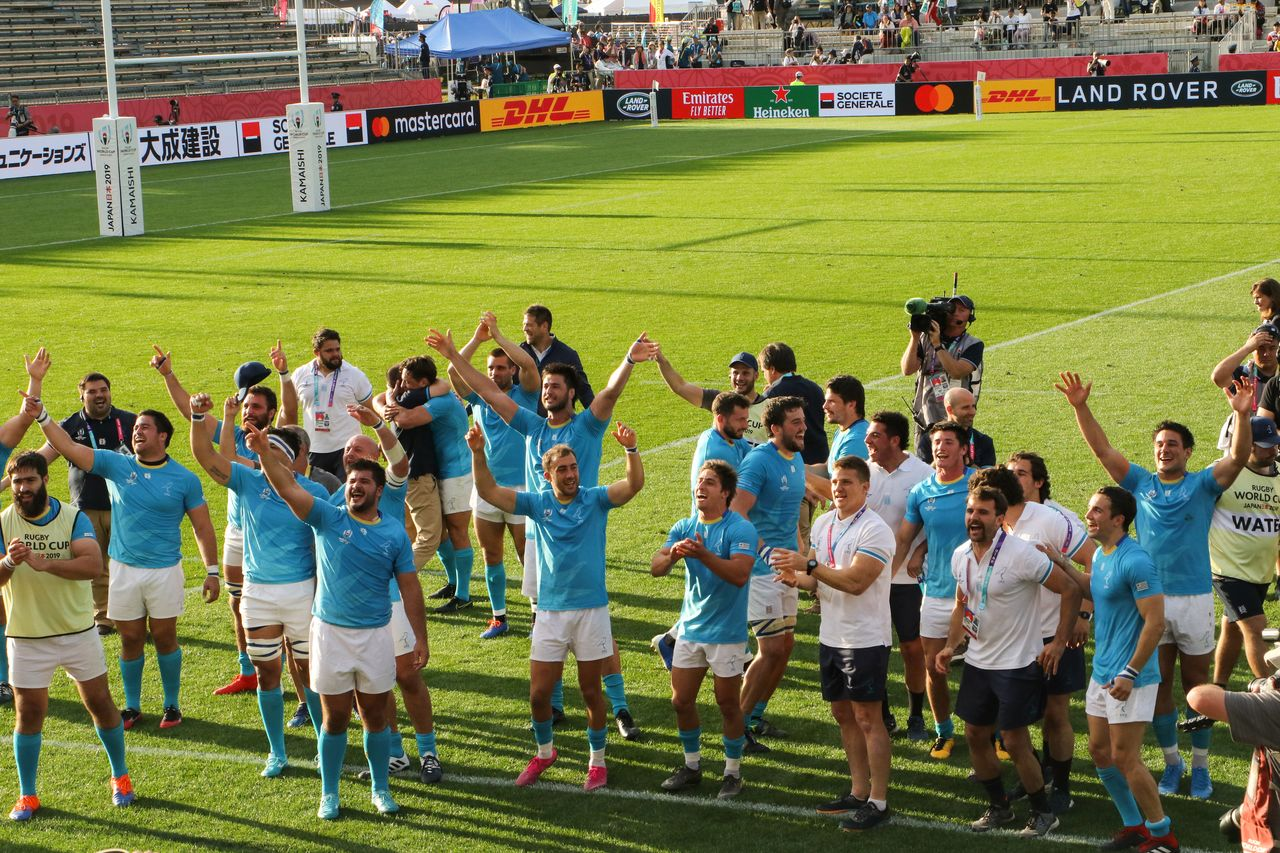 Triumphant, Uruguayan celebrates their victory over higher-ranked Fiji.