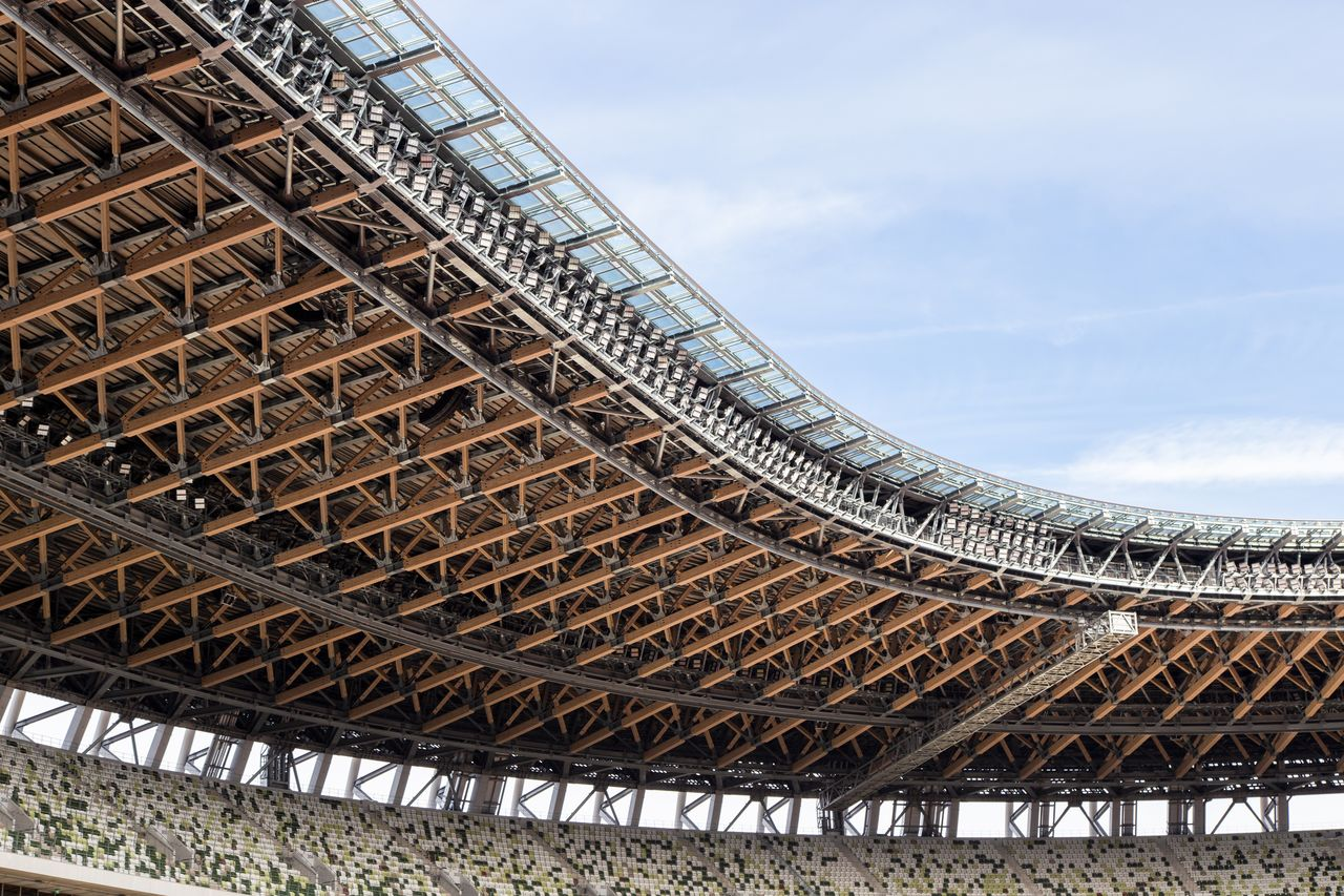 The structure supporting the 20,000-ton roof is made of wood and steel.