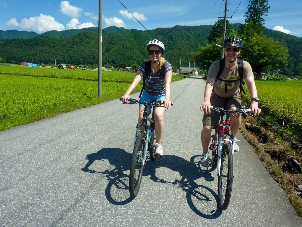 Foreign cyclists are now a common sight in the foothills of Furukawa. (Courtesy Hida Tourism Association)