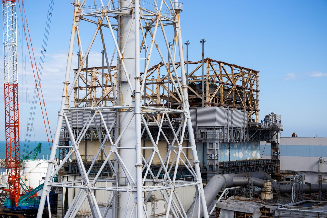 The heavily damaged Unit 1 building is the only structure housing a reactor at Fukushima Daiichi that is still uncovered.