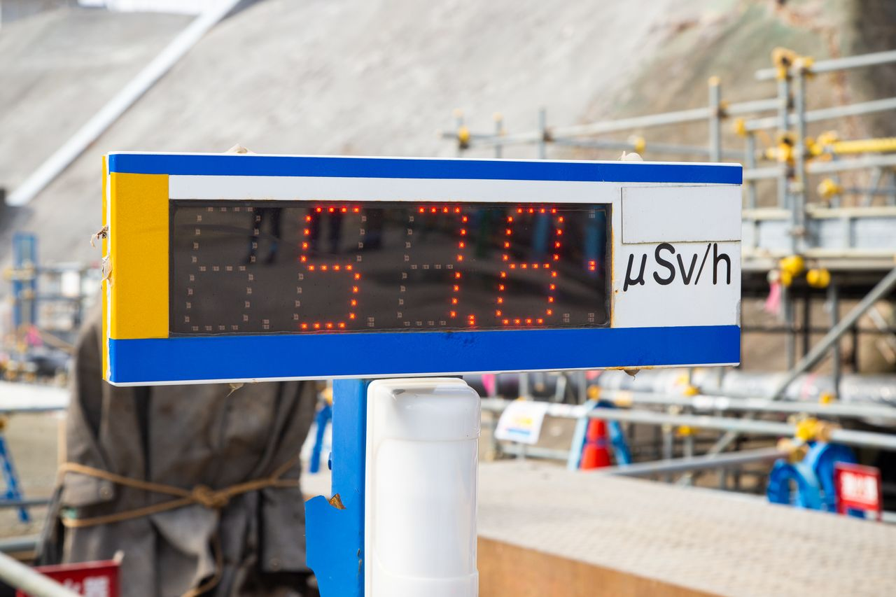 An onsite dosimeter displays radiation levels.
