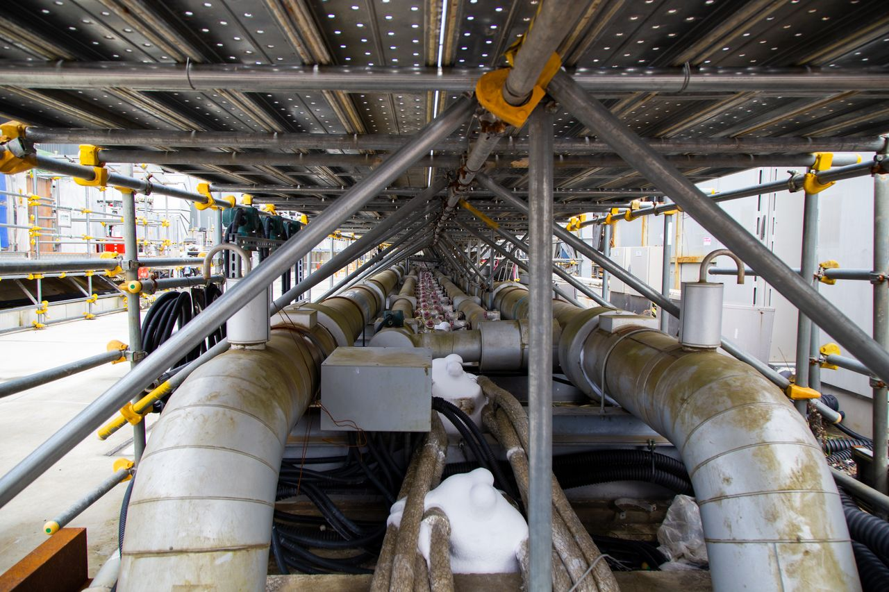 "Pipes carry coolant chilled to –30ºC to the ""ice wall."" The perimeter of frozen soil helps divert groundwater flowing toward the sea away from the reactors."