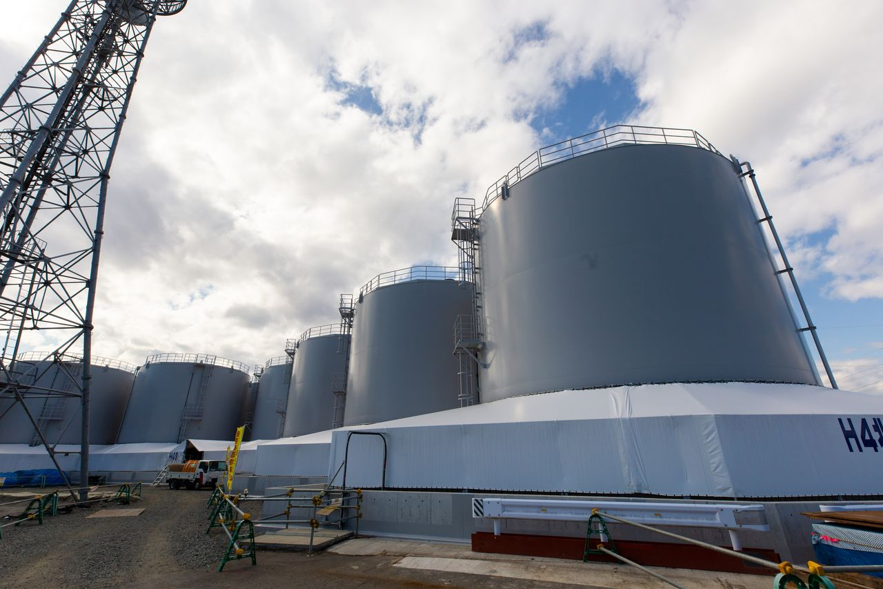 A row of steel tanks for storing treated water.