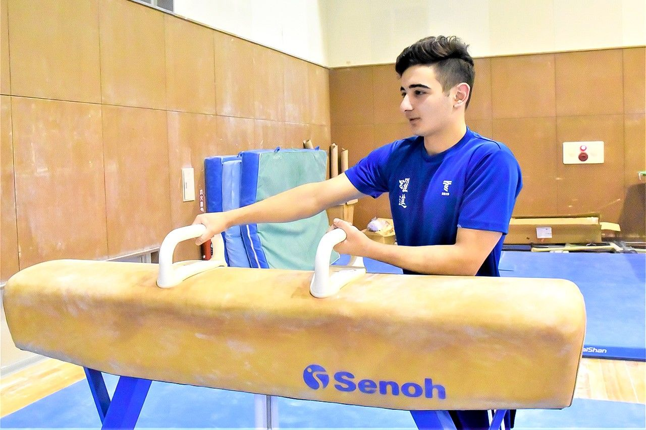 Alsouliman training for the pommel horse.