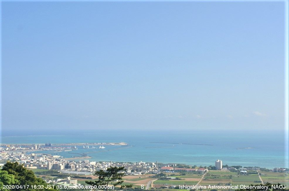 The blue sea and sky are visible during the day.