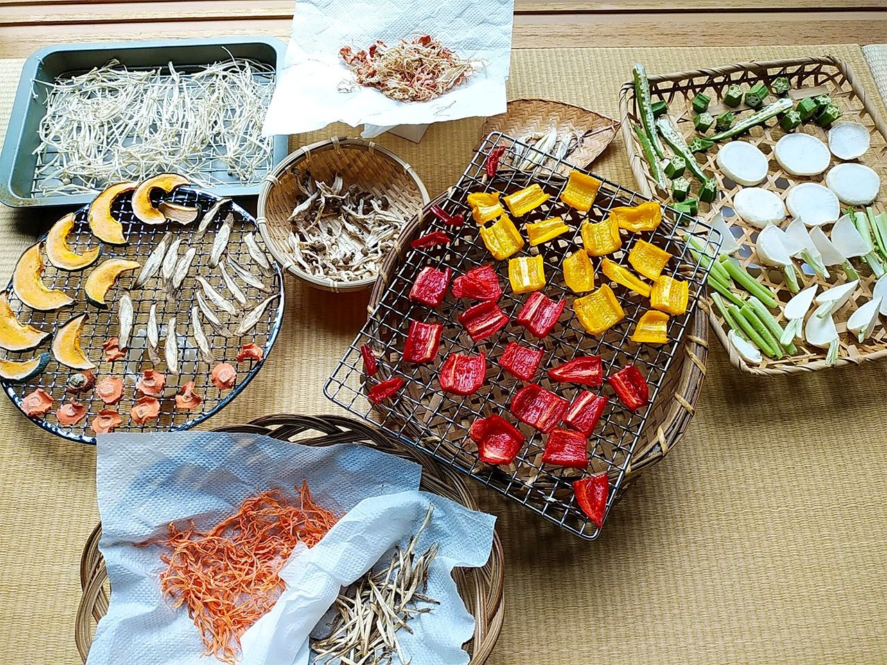 Kanbutsu can be made indoors, too. Top row, from left: enoki mushrooms, carrots, and daikon mix. Middle at left: pumpkin, carrots, and burdock; shimeji mushrooms; myōga ginger bulbs. Diagonally from bottom to right: carrots and burdock; bell peppers; and turnip slices with okra.