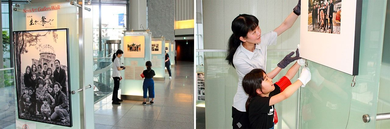 Dōune's daughter helps her mother hang the photos for the exhibit in Shiodome, Tokyo.