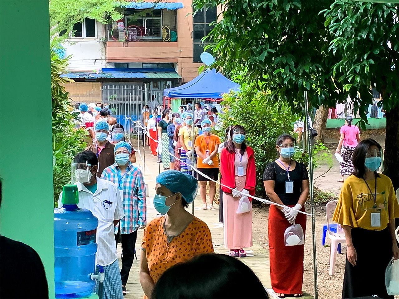 Voters maintain distance while waiting to cast their ballots as part of COVID-19 prevention measures. (Courtesy of the Nippon Foundation)