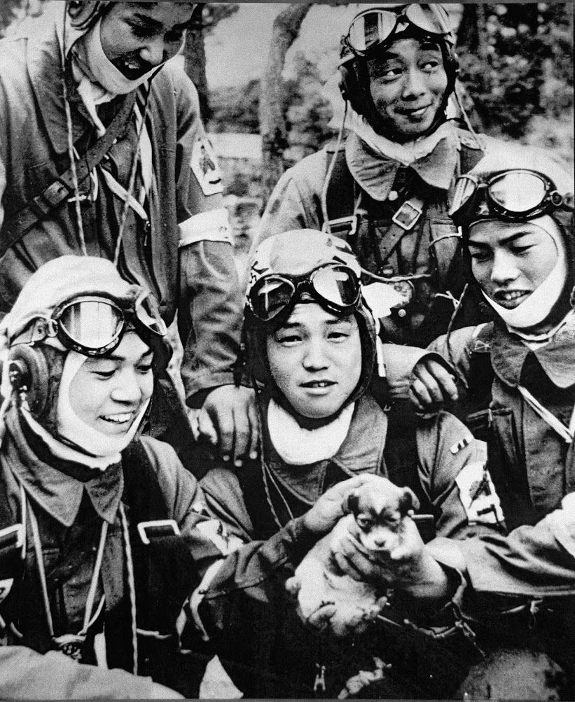 Members of a Special Attack Unit with puppy. Photo taken May 26, 1945, at the Kagoshima Bansei Aviation Ground two hours before a scheduled attack flight.