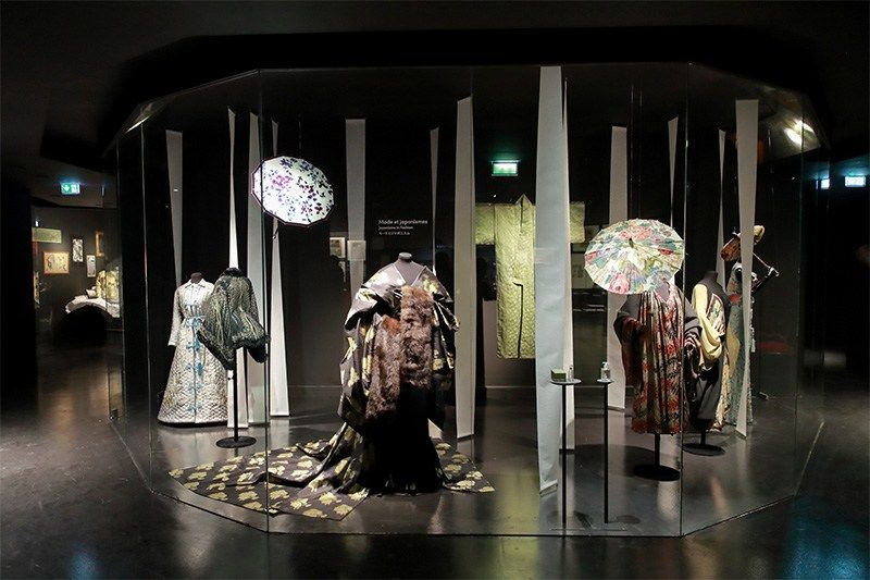 Clothing and umbrellas produced when Japonism was at its height, shown alongside a contemporary collection by John Galliano (center).