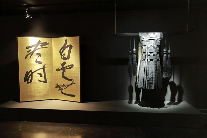 Calligraphy by Machi Shinsō (1922–1995) together with armor by a contemporary French artist.