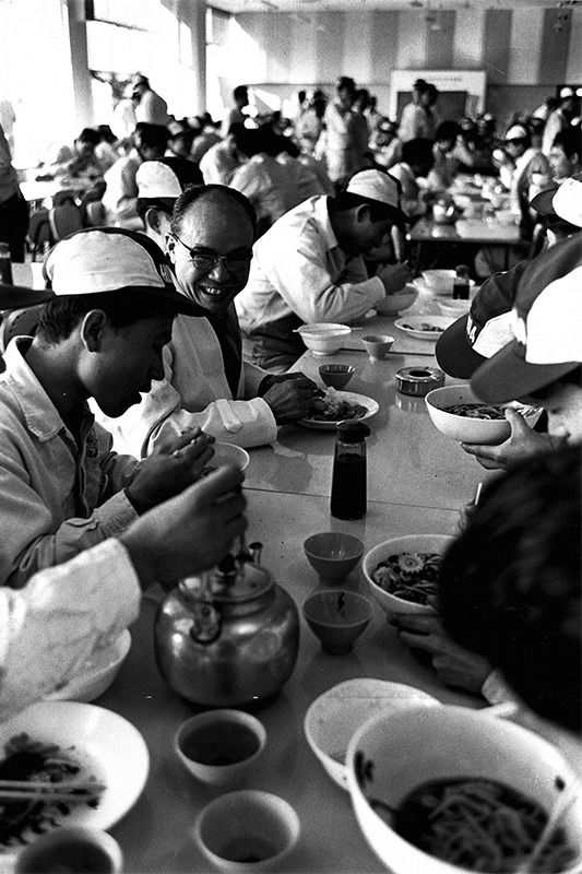 Sharing a meal with workers at the company cafeteria circa 1960.